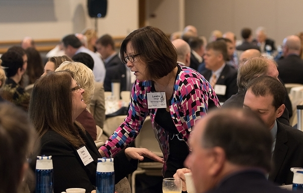 Loretta Ottinger, General Manager of RER, confers with a fellow awardee at the LVB Fastest Growing Companies breakfast.